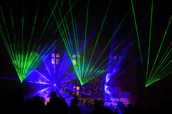 Laser show with blue green glow Royalty Free Stock Photos