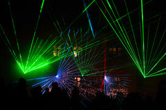 Laser show. Colorful laser show at night with audience on a place stock photo