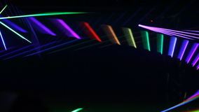 Laser show- flashes of color on a dark background stock footage