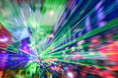 Laser show in modern disco party night club. Concept of nightlife with music and entertainment -  Image edited with radial zoom defocusing Royalty Free Stock Image