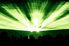 Laser show rays in green colors. Best visual show with a crowd silhouette and great laser rays for e.g. an illustration background of an invitation flyer Royalty Free Stock Image