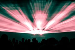 Laser show rays in nightlife party red and green colors. Best visual show with a crowd silhouette and great laser rays for e.g. an illustration background of an Royalty Free Stock Photography