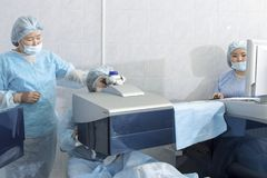 Laser surgery for vision correction stock photography