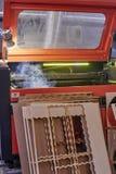 Lasermachine en malplaatjes Royalty-vrije Stock Afbeelding