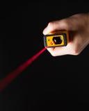 Laserowy dystansowy metr w ręce Fotografia Royalty Free