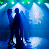 Lasers at a nightclub and people silhouettes Royalty Free Stock Images