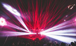 Lasers at a rave, party, club. Bright blue and purple colors Stock Images