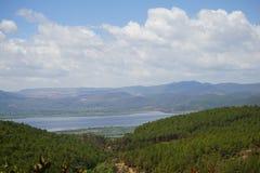 Lashi lake form afar. Lashi lake is near Lijiang.blue sky and trees royalty free stock photo