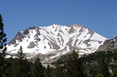 Lassen mountain. Snow covered Lassen Peak volcanic mountain in spring royalty free stock images