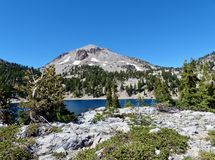 Lassen Peak, Lake Helen. Lassen Peak and Lake Helen at Lassen Volcanic National Park stock photo