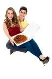 Lassen Sie uns die leckere Pizza teilen Stockfotos
