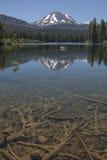 Lassen Volcano. Reflected in a lake in Lassen Volcanic National Park in California Stock Images