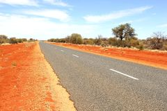 Red desert road, adventure travel in Outback Australia  Royalty Free Stock Photos