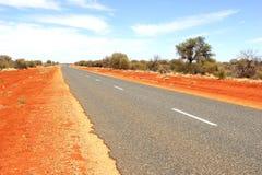 Red desert road, adventure travel in Australia  Royalty Free Stock Photos