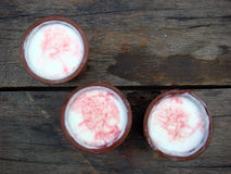 Lassi glasses. Three lassi glasses placed on wooden board Royalty Free Stock Photos
