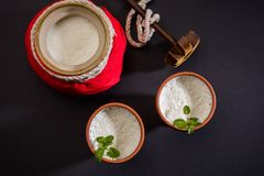 Lassie or lassi drink in terracotta glass. Lassie or lassi in terracotta glass - Lassi is an Authentic Indian cold drink made up of curd and milk and sugar royalty free stock images