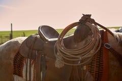 Lasso draped around the pommel of a saddle Royalty Free Stock Image