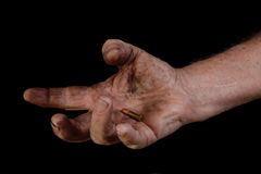 Last Bullet 3. A man's dirty hand holding a small bullet Royalty Free Stock Image
