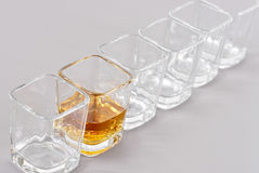 Last Call for Alcohol. Shot Of Whiskey In Square Shot Glass Royalty Free Stock Photography