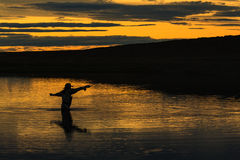 Last cast. Before dinner on RIo Gallegos, Patagonia, Argentina stock photo