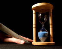 Last chance. Here is an old clock. The finger in the picture will be cut when the time is up Stock Image