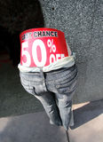 Last Chance 50 Percent Off. Funny Last Chance 50% Off big red sign posted on jeans on half of a mannequin body royalty free stock images