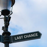 LAST CHANCE directional sign on guidepost Royalty Free Stock Image