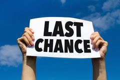 Last chance. Concept, hands holding paper sign royalty free stock photos