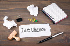 Last Chance. paper sheet from the booklet on the wooden table Stock Photo