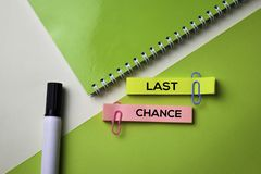 Last Chance text on top view office desk table of Business workplace and business objects stock images