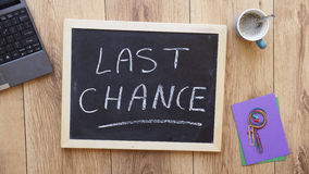 Last change written. On a chalkboard at the office stock image