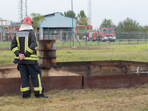 Last check. Szeged, Algyo, Hungary - October 8, 2015: Regional fire-fighting exercise in the training area with urban and contract firefighters. Fire chief is Royalty Free Stock Image
