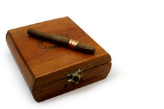 Last cigar. Left last cigar on brown wooden box royalty free stock photo