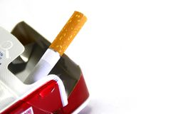 The last cigarette in the pack. Cigarette pack isolated over the white background. Can be used as a background for anti-smoking posters stock photo