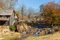Fall colors at Gresham Mill with small casades in Canton, Georgia royalty free stock photos