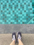 Last Day On The Pool, Top view, Woman Wearing Sneakers Stock Photography