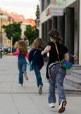 Last day of school. Girls running from the school Royalty Free Stock Image