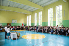 The last day of school in Ukraine. Zhytomyr, Ukraine, May 26, 2017: The last day of school in Ukraine. School meeting in the gym on the graduation day Royalty Free Stock Images
