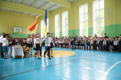 The last day of school in Ukraine. Zhytomyr, Ukraine, May 26, 2017: The last day of school in Ukraine. School meeting in the gym on the graduation day Stock Images