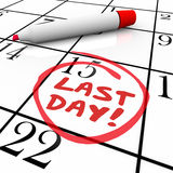 Last Day Words Circled on Calendar Deadline Expiration. Last Day words written in red marker ink on a calendar date and circled as a reminder of the deadline Royalty Free Stock Image