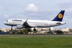 Last days of now replaced color scheme for Lufthansa. Luqa, Malta - December 3, 2018: Lufthansa Airbus A320-214 REG: D-AIUN landing runway 31. This color scheme royalty free stock photos