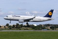 Last days of now replaced color scheme for Lufthansa. Luqa, Malta - December 3, 2018: Lufthansa Airbus A320-214 REG: D-AIUN landing runway 31. This color scheme stock photos