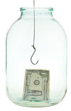 Last dollar and fishhook in glass jar Royalty Free Stock Images