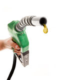 Last Drop. Male hand holding green gas noozle with one last drop on white background Royalty Free Stock Image