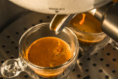 The last drops of strong espresso coffee being drawn from a espr Royalty Free Stock Photo