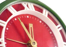Last five Minute. A macro image of an old clock on a white background Royalty Free Stock Images