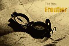 The Last Frontier. Travel: map and compass. Old and Grunge feel. Use with then name of desired destination. Other version without text in my portfolio royalty free stock image
