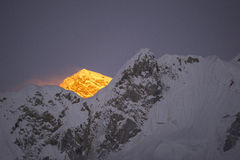 Last golden light before sunset at Everest Mountain. During the way to Everest base camp. Sagarmatha national park. Nepal Stock Photography