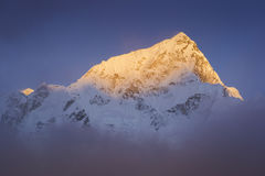 Last golden light before sunset at Lhotse-Everest Mountain. During the way to Everest base camp. Stock Image