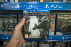 The last guardian. Bratislava, Slovakia, circa april 2017: Man holding The last guardian videogame on Sony Playstation 4 console in store Royalty Free Stock Photo